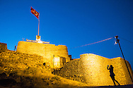 a tourist take a picture of the castle in kars