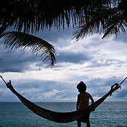 PAGUDPUD (Philippines). 2009. Boy playing with a hammock in a resort.