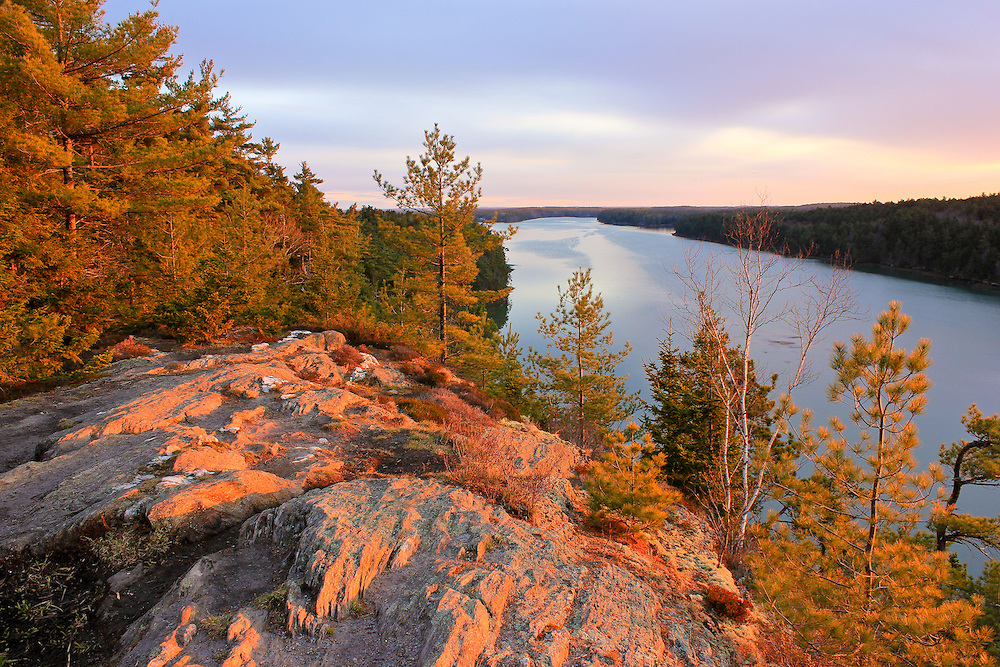 The Cliff Trail in Harpswell, Maine can be found behind the Town Offices off Mountain Road.  This little known, but very dramatic, view looks over Long Reach, and reminds viewers of some of the stunning vistas found in Acadia National Park and Camden Hills State Park.