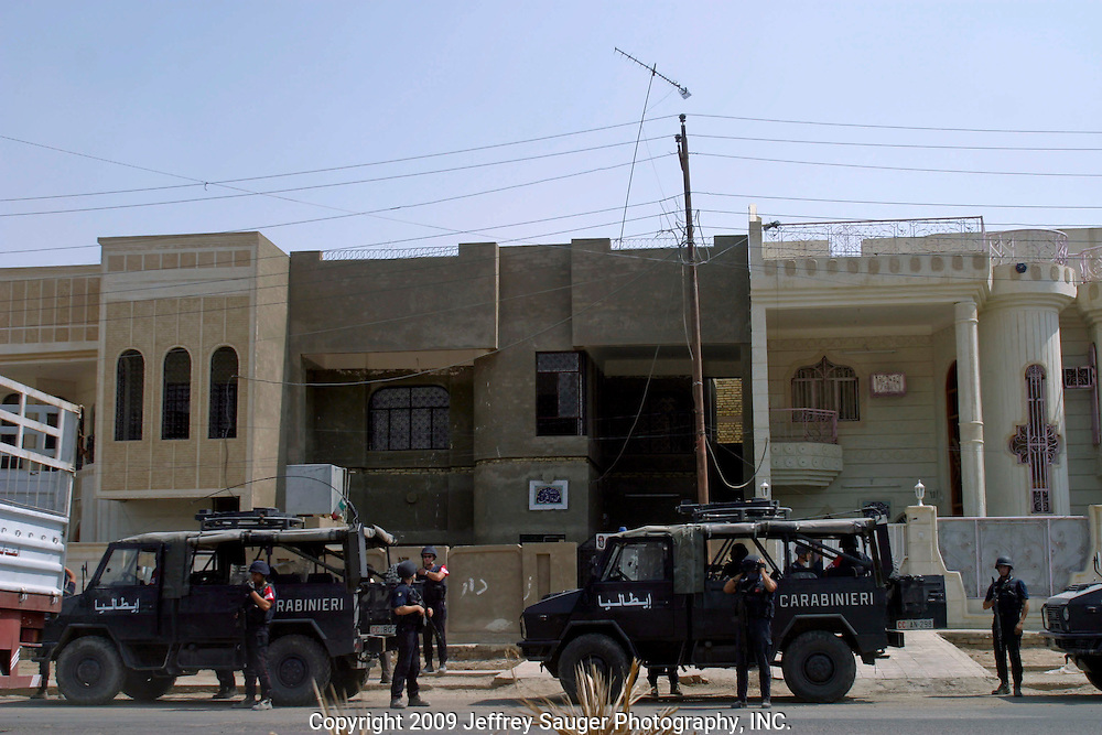 One of several convoys of Italian Carabinieri readies itself for trouble a few blocks away to the City Council Building in Nasiriyah, Iraq, Monday, August 11, 2003. Approximately 3000 peaceful protestors marched on the building, where Coalition Provencial Authority instilled city council members were holed up, demanding they resign and the citizens have the right to elect their own leaders. Heavily armed Italian troops guarded the buiding as Italian helicopters flew overhead. After several hours of negotiations, the protestors said they would not leave until the resignations were complete. Apparently by the end of the day, the resignations finally came.
