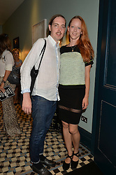 MORWENNA LYTTON COBBOLD and PHIL BUSH at the launch of Give Me Sport Magazine held at Library, 112 St.Martin's Lane, London on 30th July 2014.