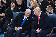 President Donald Trump chats with Vice President Mike Pence during the 68th Inaugural ceremony January 20, 2017 in Washington, DC. Trump became the 45th President  of the United States of America.