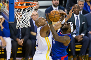 Golden State Warriors forward David West (3) fouls LA Clippers center Willie Reed (35) at the basket at Oracle Arena in Oakland, Calif., on January 10, 2018. (Stan Olszewski/Special to S.F. Examiner)