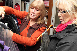 Volunteer and customer at Mysight charity shop.
