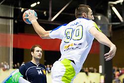 Dragan Gajic #30 of Slovenia during handball match between National teams of Slovenia and Ukraine in 6th Round of 2015 Men's World Championship Qualifications of Group 3 on January 12, 2014 in Rdeca dvorana, Velenje, Slovenia. (Photo by Urban Urbanc / Sportida)
