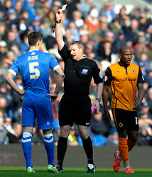 Brighton and Hove Albion's Lewis Dunk is shown a yellow card by Match Referee Trevor Kettle - Photo mandatory by-line: Harry Trump/JMP - Mobile: 07966 386802 - 14/03/15 - SPORT - Football - Sky Bet Championship - Brighton v Wolves - Amex Stadium, Brighton, England.