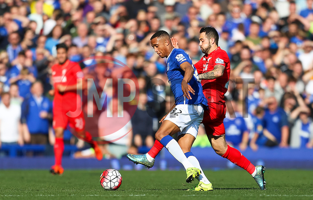 Everton's Brendan Galloway closed down by Danny Ings of Liverpool  - Mandatory byline: Matt McNulty/JMP - 07966 386802 - 04/10/2015 - FOOTBALL - Goodison Park - Liverpool, England - Everton  v Liverpool - Barclays Premier League