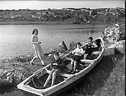 Carna. Boat Bulding with the Cloherty family 14th May 1959. Children playing in a boat.<br />