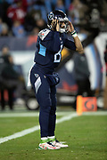 Tennessee Titans quarterback Marcus Mariota (8) holds his hands to his helmet as he listens on his helmet communication device during the week 14 regular season NFL football game against the Jacksonville Jaguars on Thursday, Dec. 6, 2018 in Nashville, Tenn. The Titans won the game 30-9. (©Paul Anthony Spinelli)