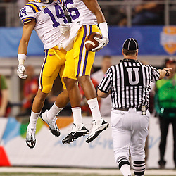 Jan 7, 2011; Arlington, TX, USA; LSU Tigers cornerback Tyrann Mathieu (14) and cornerback Tharold Simon (26) celebrate following a turnover against the Texas A&M Aggies during the second quarter of the 2011 Cotton Bowl at Cowboys Stadium.  Mandatory Credit: Derick E. Hingle