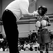 A USA Boxing official gives a distraught 8-year-old Tyree Charles a standing eight-count during the first round of a Junior Olympic bantam division bout at the 2008 Virginia State Amateur Boxing Championships in Virginia Beach. Following three more standing eight-counts in the next round and a half, Charles was given the loss in the third round by technical knockout.