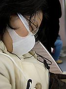 Japanese girl in subway wearing a mask to protect against pollen