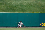 ST. LOUIS, MO - JUNE 30: Andrew McCutchen #22 of the Pittsburgh Pirates can't make the play on a deep fly ball hit by Tony Cruz of the St. Louis Cardinals during the game at Busch Stadium on June 30, 2012 in St. Louis, Missouri. The Pirates won 7-3 as temperatures reached 103 degrees during the game. (Photo by Joe Robbins)
