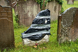 "© Licensed to London News Pictures; 18/06/2020; Bristol, UK. The grave of Scipio Africanus at St Mary's Churchyard in Henbury has been vandalised with part of the memorial broken in two in an attack on Tuesday night. The elaborate grave is grade II listed, and both stones that featured black cherubs marking the grave of 18-year-old ""Scipio Africanus"" were damaged. A message was also left which indicates the attack was in revenge for the toppling of the statue of slave trader Edward Colston in Bristol city centre during a Black Lives Matter protest on 07 June 2020, with part of the message saying ""put Colston back"". Scipio Africanus (1702 – 21 December 1720) was a slave born to unknown parents from West Africa. He was named after Publius Cornelius Scipio Africanus, the third century BCE Roman general, famous for defeating the Carthaginian military leader Hannibal. Very little is known of his life. He was the servant of Charles William Howard, 7th Earl of Suffolk, who in 1715 married Arabella Morse and lived in the ""Great House"" in Henbury, Bristol. It is not known how Scipio was acquired, but he died there aged, according to his headstone, eighteen. His master and mistress died two years later. Black Lives Matter protests around the world have come after George Floyd a black man was killed by a white police officer in Minneapolis in the US. Photo credit: Simon Chapman/LNP."