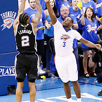 06 May 2016: San Antonio Spurs forward Kawhi Leonard (2) takes a jump shot over Oklahoma City Thunder guard Dion Waiters (3) during the San Antonio Spurs 100-96 victory over the Oklahoma City Thunder, during Game Three of the Western Conference Semifinals of the NBA Playoffs at the Chesapeake Energy Arena, Oklahoma City, Oklahoma, USA.