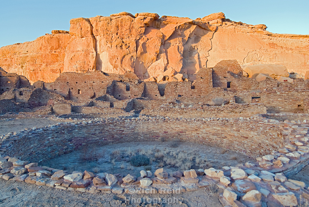 Sunset on the Great Kiva in the plaza of Pueblo Bonito in Chaco Culture National Historical Park, New Mexico.