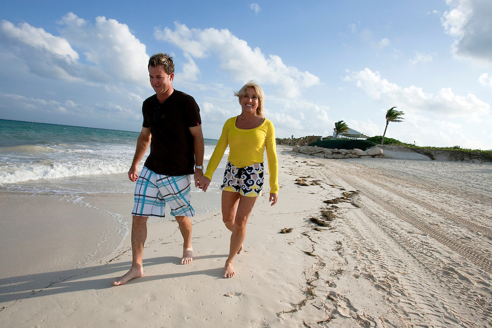 Brian Gay, 2008 champion of the Mayakoba Golf Classic at Riviera Maya-Cancun, a PGA Tour tournament held along the Caribbean in the Riviera Maya, walks with his wife, Kimberly, on the beach.