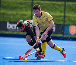 Team Bath Buccaneers' James Corry beats Russell Hornby of Bowdon. Bowdon v Team Bath Buccaneers - Now: Pensions Finals Weekend, Lee Valley Hockey & Tennis Centre, London, UK on 11 April 2015. Photo: Simon Parker