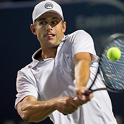 August 21, 2014, New Haven, CT:<br /> Andy Roddick hits a backhand during the Men's Legends Event on day seven of the 2014 Connecticut Open at the Yale University Tennis Center in New Haven, Connecticut Thursday, August 21, 2014.<br /> (Photo by Billie Weiss/Connecticut Open)