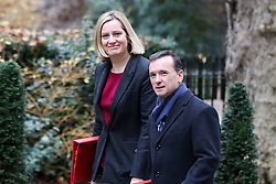 "© Licensed to London News Pictures. 18/12/2018. London, UK. Amber Rudd - Secretary of State for Work and Pensions (L) and Alun Cairns - Secretary of State for Wales (R) arrives in Downing Street for the weekly Cabinet meeting. The Cabinet will discuss the preparations for a ""No Deal"" Brexit. Photo credit: Dinendra Haria/LNP"
