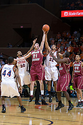 Virginia forward Mike Scott (32) and Boston College forward Tyler Roche (21) battle for the opening tip.  The Virginia Cavaliers men's basketball team faced the Boston College Golden Eagles at the John Paul Jones Arena in Charlottesville, VA on January 19, 2008.