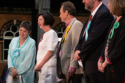© Licensed to London News Pictures . 26/05/2019. Manchester, UK. L-R winners CLAIRE FOX (Brexit Party), THERESA GRIFFIN (Labour Party), CHRIS DAVIES (Liberal Democrats), HENRIK NIELSEN (Brexit Party), GINA DOWDING (Green Party)  . The count for seats in the constituency of North West England in the European Parliamentary election , at Manchester Central convention centre . Photo credit: Joel Goodman/LNP