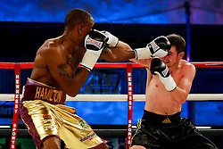 Darren Hamilton (gold shorts, red trim) beats  Mikheil Avakyan (black shorts, gold trim) by majority decision in a Super Lightweight bout on the undercard - Photo mandatory by-line: Rogan Thomson/JMP - 07966 386802 - 13/06/2015 - SPORT - BOXING - Bristol, England - Action Indoor Sports Arena - Lee Haskins vs Ryosuke Iwasa - Interim IBF World Bantamweight Title Fight - UNDERCARD.
