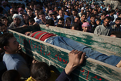 Neighbours and relatives are carrying a coffin with the body of a civilian, Abed Alsalam Khazal, 20 in his funeral in Anadan, North Syria, saturday, April 21, 2012..Saturday morning eight members of the FSA and one civilian were killed as a result of an ambush made by mercenaries and security forces close to a checkpoint in the outskirts of Babis, north Aleppo. ..*In this town, 10 people were  found dead, 15 wounded and one missing in an attack where 18 tanks, 14 military cars and around 300 soldiers burned down 118 houses and 120 shops in a operation by the Syrian regime of Bashar-Al-Assad at April 13th and 14th activist says, Syria, April 21, 2012. Photo by Daniel Leal-Olivas / i-Images...