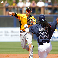 February 26, 2011; Port Charlotte, FL, USA; Pittsburgh Pirates second baseman Neil Walker (18) forces out Tampa Bay Rays left fielder Manny Ramirez (24) and throws to first base to complete a double play during a spring training exhibition game at Charlotte Sports Park.  Mandatory Credit: Derick E. Hingle