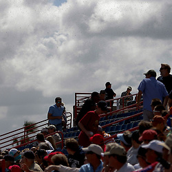 March 4, 2011; Viera, FL, USA; Fans scramble out of their seats to avoid a swarm of bees that passed through the stadium during a spring training exhibition game between the Atlanta Braves and Washington Nationals at Space Coast Stadium.  Mandatory Credit: Derick E. Hingle