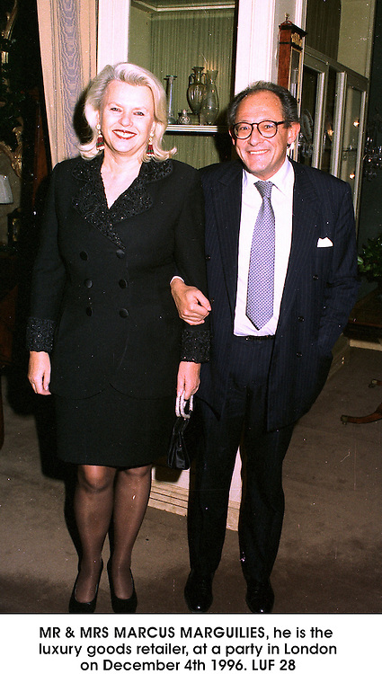 MR & MRS MARCUS MARGUILIES, he is the luxury goods retailer, at a party in London on December 4th 1996.LUF 28