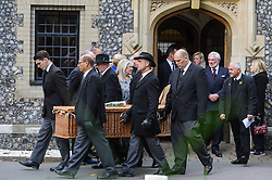 © Licensed to London News Pictures. 07/10/2014London, UK.  The coffin leaves the funeral service of singer Lynsey de Paul in Hendon, North London. Photo credit : Simon Jacobs/LNP
