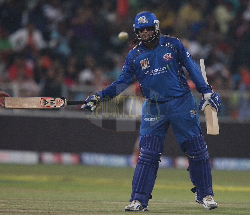 Saurabh Tiwary  gets Dwayne Bravo  bat back from Dale Steyn during match 15 of the Airtel CLT20 between The Mumbai Indians and the Royal Challengers Bangalore held at Kingsmead Stadium in Durban on the 19 September 2010..Photo by: Steve Haag/SPORTZPICS/CLT20.