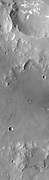 Two landslide deposits are located on the southern side of Columbus Crater in Terra Sirenum.