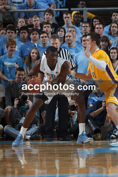 CHAPEL HILL, NC - DECEMBER 15: Joel James #0 of the North Carolina Tar Heels defends during a game against the East Carolina Pirates on December 15, 2012 at the Dean E. Smith Center in Chapel Hill, North Carolina. North Carolina won 93-87.  *** Local Caption *** Joel James