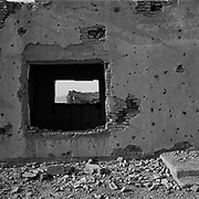 A view through a window of one of many residential buildings destroyed by U.S. bombs at Tarnak Farms, the al Qaeda base, training camp and pre 9/11 al Qaeda headquarters in Kandahar, Afghanistan which served as a home to Osama Bin Laden and numerous al Qaeda fighters located outside Kandahar City. It is believed that this base was where the plan for the 9/11 attacks originated, as a result Tarnak Farms was heavily bombed by the United States after September 11, 2001. (Credit Image: © Louie Palu/ZUMA Press).