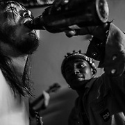 Thula (right) makes the guitarist of the punk band The Write Off drink beer during their performance at the Punk Fuck even in Soweto. The Write Off's members travelled from Durban, a coastal city in eastern South Africa's KwaZulu-Natal province to join the event in Soweto. Johannesburg, South Africa. April 2017. © Miora Rajaonary / Native Agency