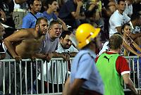 30.08.2012 <br /> FK Partizan-Tromsø IL<br />  Europa League play off<br />  men's football<br />  FK Partizan fans(Left) provocate TROMSØ IL reserve player(r) during warm-up
