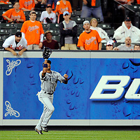 09 June 2009:  Seattle Mariners left fielder Endy Chavez (10) makes a catch on fly ball off the bat of Baltimore Orioles first baseman Aubrey Huff in the 1st inning at Camden Yards in Baltimore, MD.  The Orioles defeated the Mariners 3-1.  ****For Editorial Use Only****
