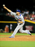 Sep. 27 2011; Phoenix, AZ, USA; Los Angeles Dodgers pitcher Josh Lindblom(52) delivers a pitch during the ninth inning against the Arizona Diamondbacks at Chase Field. The Diamondbacks defeated the Dodgers 7-6 in extra innings.    Mandatory Credit: Jennifer Stewart-US PRESSWIRE.