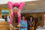 Young mongolian acrobat in traditional costume