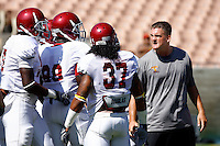 21 August 2008: Defensive Line coach David Watson makes a mean face at his players  during USC Trojans Pac-10 NCAA College football team final intrasquad scrimmage of fall camp in front of 8,000 fans in the Los Angeles Memorial Coliseum near school campus.  White team (1st and 2nd teamers) defeated the Cardinal (reserves) team 28-7 on Thursday.
