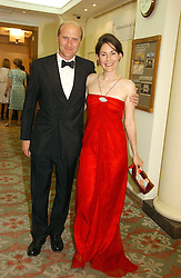 The 5th MARQUIS & MARCHIONESS OF NORMANBY at a private view of the forthcoming sale 'Property from the collection of HRH The Princess Margaret, Countess of Snowdon' and a private view of art by Marina Karella Princess Michael of Greece, held at Christie's, 8 King Street, London SW1 on 12th June 2006.<br />