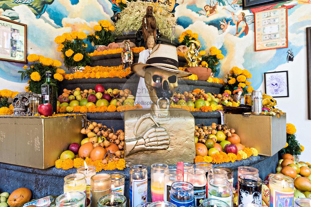 A shrine and offerings inside the La Casa De La Santa Muerte or House of the Saint of the Dead November 1, 2017 in Santa Ana Chapitiro, Michoacan, Mexico.