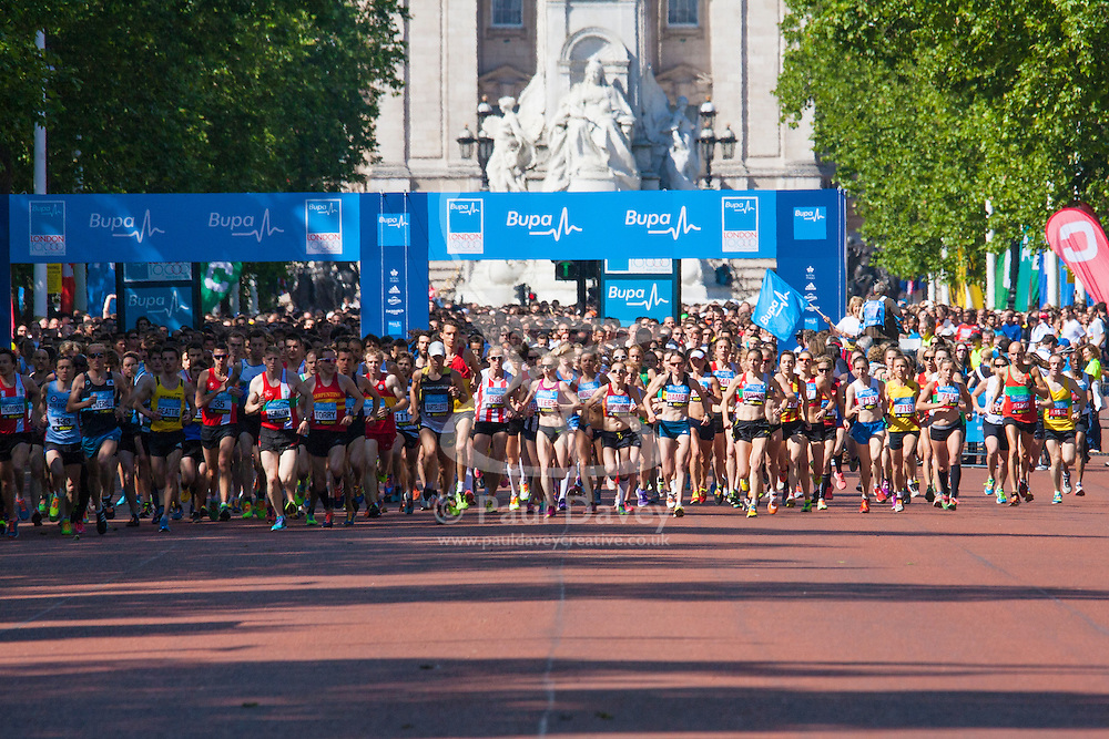 London, May 25th 2014. Elite class runners set off in the BUPA 10km run in London.