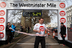 © Licensed to London News Pictures.  14/03/2012. LONDON, UK.  George Eustice, MP for Camborne Redruth and Hayle (pictured), crosses the line to win the Westminster Mile  in a time of 5 minutes 28 seconds. The Sport Relief Westminster Mile is run by MPs and Peers in St James Park each year in aid of the charity. Photo credit :  Cliff Hide/LNP