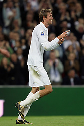 Peter Crouch of England celebrates  after he scores to make it 3-0