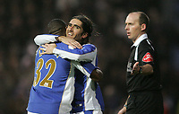 Photo: Lee Earle.<br /> Portsmouth v Manchester City. The Barclays Premiership. 10/02/2007. Lomana Lua Lua (L) congratulates Pedro Mendes after he scored Portsmouth's opening goal.