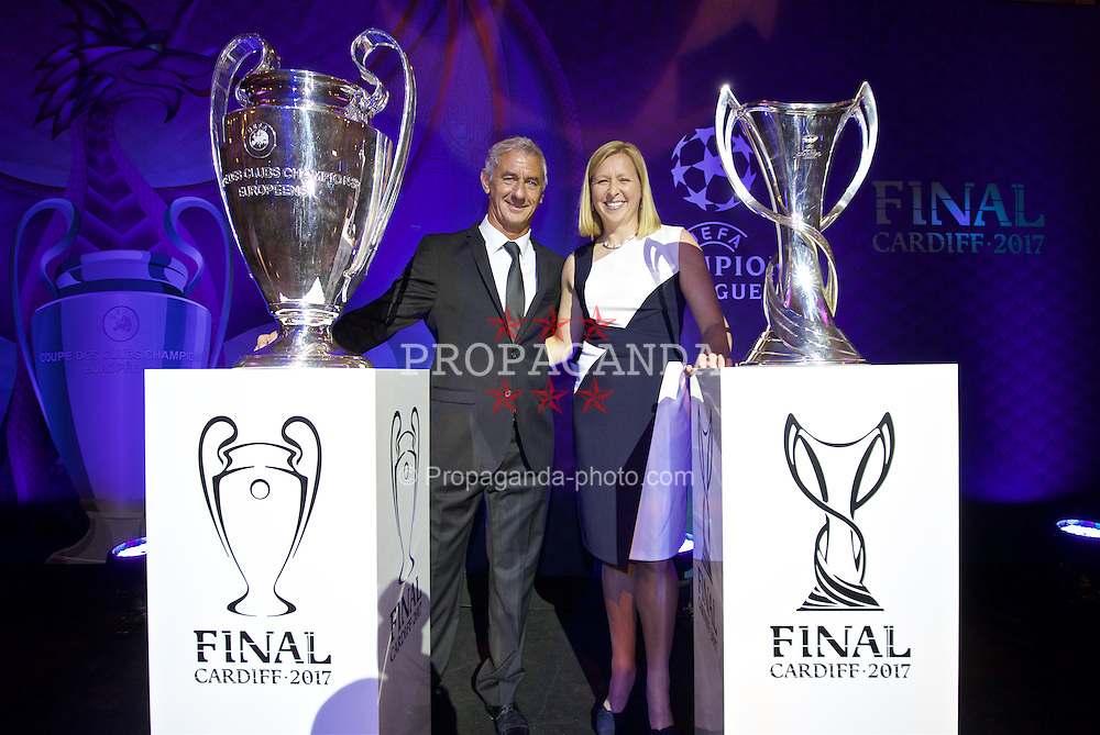 CARDIFF, WALES - Wednesday, August 31, 2016: Former Wales international Ian Rush, a two time winner with Liverpool, and Wales women's team manager Jayne Ludlow deliver the European Cup trophies during a gala dinner at the Cardiff Museum to launch the UEFA Champions League Finals 2017 to be held in Cardiff. (Pic by David Rawcliffe/Propaganda)