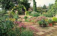 stone paved patio with planting in stone trough